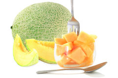 Cantaloupe melon cut and whole in pure white background Stock Image