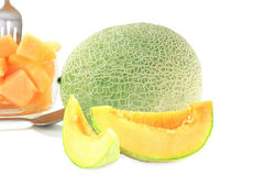 Cantaloupe melon cut and whole in pure white background Royalty Free Stock Images