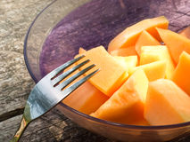 Cantaloupe melon. A dessert of pieces of orange cantaloupe melon in a plastic bowl royalty free stock photography