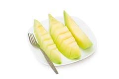 Cantaloupe melon fruit in dish Isolated on white background Royalty Free Stock Image