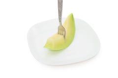 Cantaloupe melon fruit in dish Isolated on white background Stock Photo