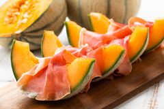 Slices of cantaloupe melon with ham Royalty Free Stock Photography