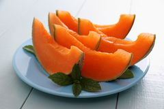 Cantaloupe melon with mint as healthy refreshment stock photos