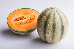 Cantaloupe melon, one and a half. On white background, closeup Stock Photos