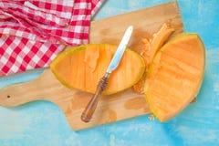 Cantaloupe melon peel on rustic table Royalty Free Stock Photo