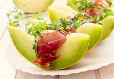 Cantaloupe Melon with Prosciutto and Arugula Stock Image