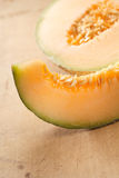 Cantaloupe melon slice and one half Stock Photos
