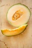 Cantaloupe melon slice and one half Stock Photography