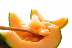 Cantaloupe melon slice on white background Royalty Free Stock Images