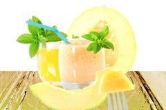 Cantaloupe melon smoothie or milkshake with fruit juice and stevia Stock Image