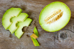 Cantaloupe melon. On wooden background Royalty Free Stock Photos