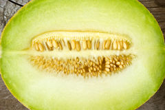 Cantaloupe melon. On wooden background Royalty Free Stock Images