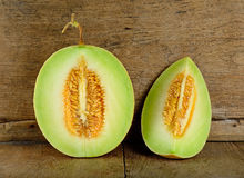 Cantaloupe melon on the wooden background Stock Images