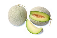 Cantaloupe melons with slices ready to eat Stock Photography