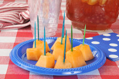 Cantaloupe on a picnic table Royalty Free Stock Images