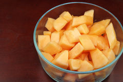 Cantaloupe Pieces in a Clear Glass Bowl on Wood Stock Photos