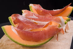 Cantaloupe and Prosciutto Stock Photo