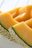 Cantaloupe slice. Sliced cantaloupe close up to rind and flesh, juicy look Royalty Free Stock Photos