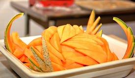Cantaloupe slices arranged on a tray Stock Photography
