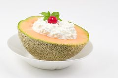 Cantaloupe snack. A half of a cantaloupe and a scoop of lite cottage cheese make for a nutritious morning or afternoon snack Stock Image