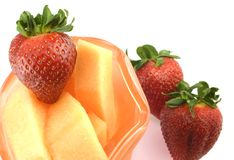Cantaloupe and Strawberries Stock Photos
