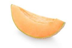 Cantaloupmelonmelonskiva på vit Royaltyfria Bilder