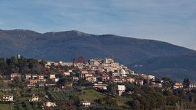 Cantalupo and Sabine mountains, rieti, lazio, italy. View of the village of Cantalupo in Sabina and of the Sabine mountains, Rieti, Lazio, Italy royalty free stock images