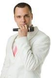 Cantante dell'uomo con il microfono isolato Fotografia Stock