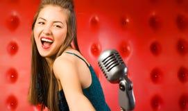 Cantante della giovane donna Fotografia Stock