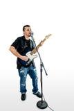 Cantante Guitarist su bianco inclinato fotografia stock libera da diritti