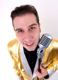 Cantante joven en la chaqueta de Elvis del oro Fotos de archivo