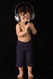 Cante al bebé. Foto de archivo libre de regalías