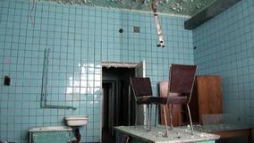 Canteen dining room in Pyramiden Spitsbergen Arctic. Russian neglected township. Canned place times of Soviet Union. Time stood still of North Pole stock video footage