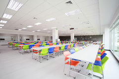 Canteen. Interior with blue, green, orange chairs stock images
