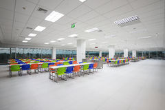 Canteen. Interior with white table and blue, green, orange chairs royalty free stock photography