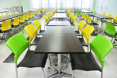 Canteen. Interior of the canteen with Yellow chair, Green chair stock image
