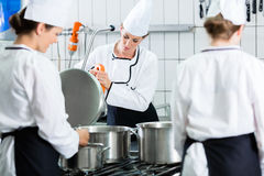 Canteen kitchen with chefs during service royalty free stock photos