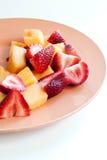 canteloupe högg av jordgubbar Fotografering för Bildbyråer
