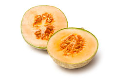 Canteloupe Halves with Seeds Isolated. Cantaloupe melon cut in half showing seeds isolated on a white background royalty free stock photography