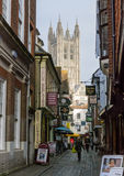 Canterbury Cathedral at the bottom of the cobbled Butchery Lane. Stock Photography