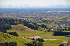 Canterbury Plains, New Zealand. An early spring view across the fields and farms of the Canterbury Plains to the ski fields in the Southern Alps. Christchurch is Royalty Free Stock Images
