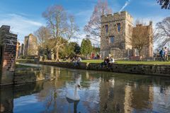 People strolling and enjoying themselves along Great Stour river Royalty Free Stock Photos
