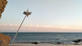 Canti sulla spiaggia al tramonto fotografia stock