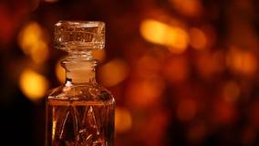 Cantidad de cristal del hd del bokeh del oro del perfume almacen de metraje de vídeo