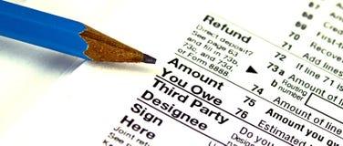Cantidad del impuesto que usted debe Imágenes de archivo libres de regalías