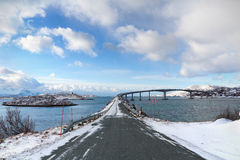 Cantilever bridge in arctic Norway. Road leading to Sommarøy island through a cantilever bridge in a winter arctic landscape royalty free stock images