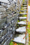 Cantilevered steps, slate  in wall Royalty Free Stock Image