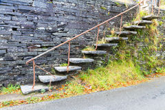 Cantilevered steps, slate  in wall Royalty Free Stock Photo