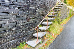 Cantilevered steps, slate  in wall Royalty Free Stock Photos