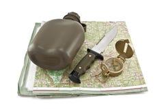 A cantina do exército, uma faca e um compasso estão no mapa Imagem de Stock